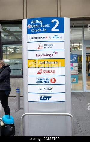 Airline Departure check in sign outside Nuremberg Airport - Stock Photo
