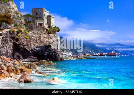 Beautiful Monterosso al Mare,view with turquoise sea,old castle and mountains,Cinque Terre,Liguria,Italy. - Stock Photo