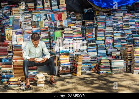 Books for sale at street side market stall near Flora Fountain in Mumbai. India - Stock Photo