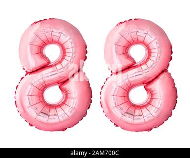 Number 88 eighty eight of rose gold inflatable balloons isolated on white background. Pink helium balloons forming 88 eighty eight number - Stock Photo