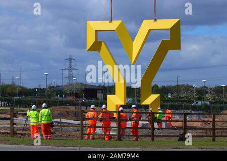 The Welcome To Yorkshire 'Y' sculpture being lifted into position by crane in Parrots Corner,Doncaster. - Stock Photo