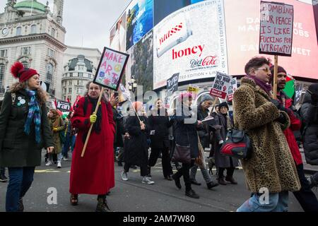 London, UK. 11 January, 2020. Anti-war activists attend the No War on Iran demonstration organised by Stop the War Coalition and the Campaign for Nuclear Disarmament to call for deescalation in the Middle East following the assassination by the United States of Iranian General Qassem Soleimani and the subsequent Iranian missile attack on US bases in Iraq. Credit: Mark Kerrison/Alamy Live News - Stock Photo
