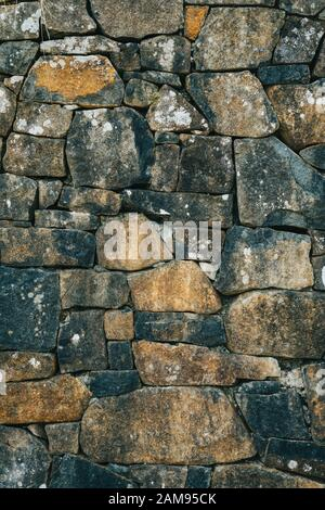 Old style stacked stone wall texture. - Stock Photo
