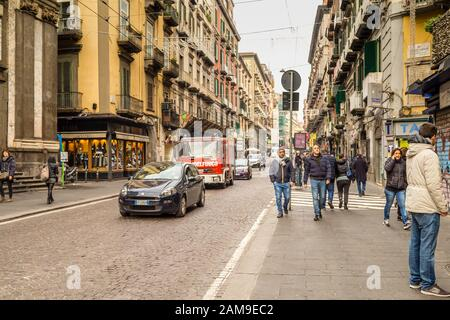 NAPLES, ITALY - JANUARY 4, 2020: tourists visiting historical center - Stock Photo