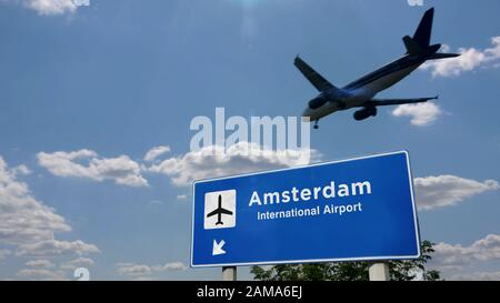 Airplane silhouette landing in Amsterdam, Netherlands, Holland. City arrival with international airport direction signboard and blue sky in background - Stock Photo