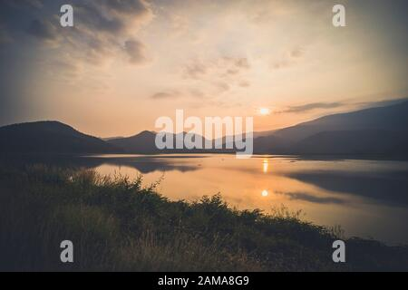 Mountain, sky and river in a quiet and cool atmosphere. Similar color scheme .View of blue mountains with reflection in lake . Landscape with blue mou - Stock Photo