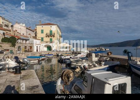 Valun, Island Cres, Croatia - January 1, 2020:  old town and port of Valun.It´s a small fishing village on the island Cres in the kvarner gulf in croa - Stock Photo