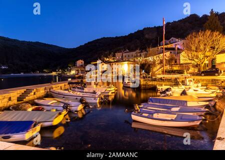 Valun, Island Cres, Croatia - December 31, 2019:  evening in the old town of Valun.It´s a small fishing village on the island Cres in the kvarner gulf - Stock Photo