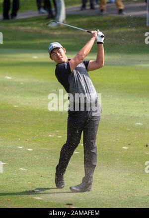 Fanling, Hong Kong, China. 12th Jan 2020.  61st Hong Kong Open Golf Final Round. Gunn Charoenkul of Thailand on the 4th fairway. Credit: HKPhotoNews/Alamy Live News - Stock Photo