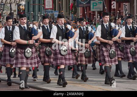 Bagpipe band at Dickens on The Strand parade, The Strand, Galveston, Texas, USA - Stock Photo