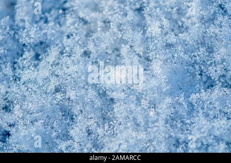 Lots of beautiful winter snowflakes in the sun. background - Stock Photo
