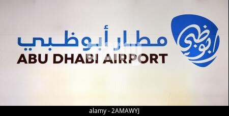 A sign at Abu Dhabi Airport, Abu Dhabi, United Arab Emirates - Stock Photo