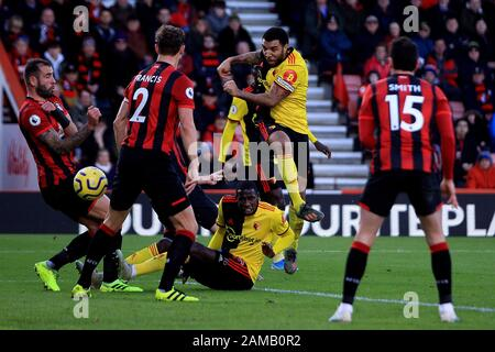 Bournemouth, UK. 12th Jan, 2020. Troy Deeney of Watford (c) shoots and scores his team's second goal. Premier League match, AFC Bournemouth v Watford at the Vitality Stadium in Bournemouth, Dorset on Sunday 12th January 2020. this image may only be used for Editorial purposes. Editorial use only, license required for commercial use. No use in betting, games or a single club/league/player publications. pic by Steffan Bowen/ Credit: Andrew Orchard sports photography/Alamy Live News