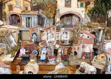 ROME, ITALY - DECEMBER 10, 2016: Shop with Christmas cribs in a street market - Stock Photo