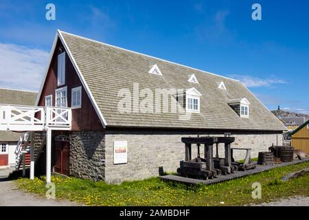 Displays outside part of Greenland National Museum housed in a wooden building. Nuuk (Godthab), Sermersooq, Greenland - Stock Photo