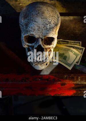 Human skull and dollars dirty Red blood money view from above table top tabletop - Stock Photo