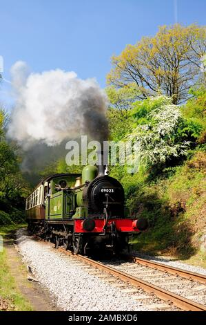 LNER Class J72 0-6-0 No 69023 Joem passing Beck Hole on the North Yorkshire Moors Railway. (photographed from a safe location) - Stock Photo