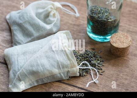 Dried organic lavender flowers in muslin pouches for use in dryer as a replacement for dryer sheets. - Stock Photo