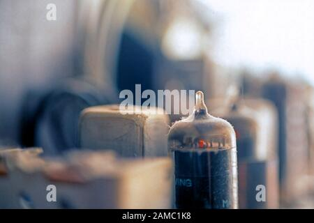 Dusty old vacuum tubes inside a radio - Stock Photo
