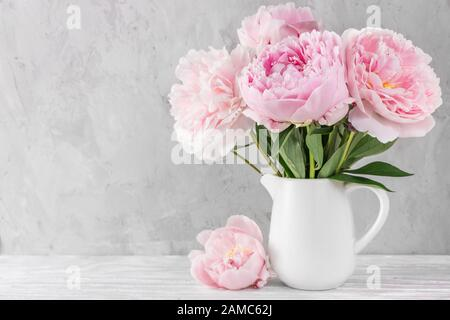pink peony flowers bouquet on white background with copy space. still life. womens day or wedding concept. festive background - Stock Photo