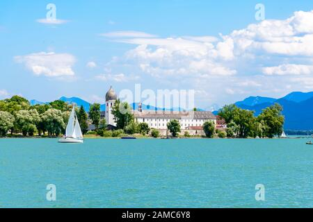 Fraueninsel, Frauenchiemsee on lake Chiemsee with boat, Sailboat, church, monastery. Bavaria, Bayern, Germany - Stock Photo