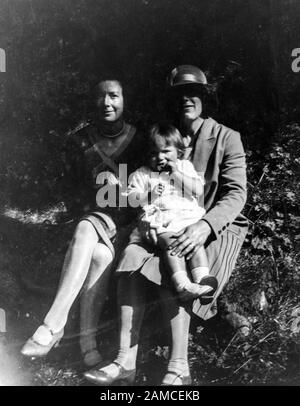 Archive image of two ladies with a toddler, circa 1920s, scanned directly from the negative - Stock Photo