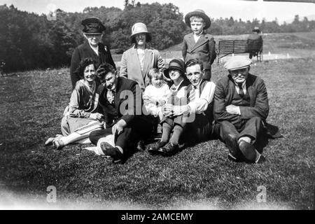 Archive image of a family group outside in a park, circa 1920s scanned directly from the negative - Stock Photo