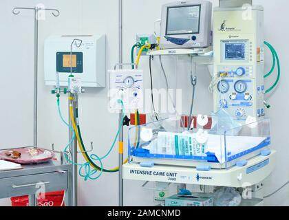 Neonatal intensive care unit with resuscitation device, vital signs monitor and oxygen lines.  Children Hospital. Guayaquil.  Ecuador - Stock Photo