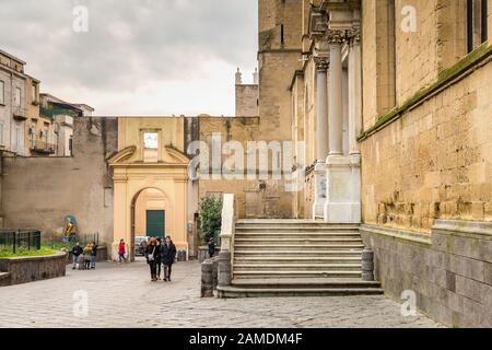 NAPLES, ITALY - JANUARY 4, 2020: tourists visiting THE monumental complex of Santa Chiara - Stock Photo