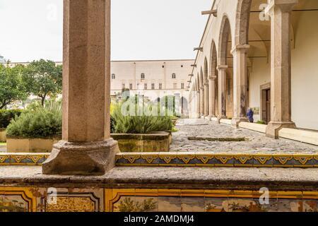 NAPLES, ITALY - JANUARY 4, 2020: tourists visiting the monumental complex of Santa Chiara - Stock Photo