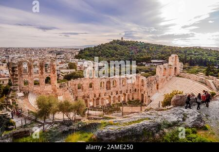 Athens / Greece - March 2 2014: The Odeon of Herodes Atticus, located on the southwest slope of the Acropolis. Filopappos Hill (with the Filopappos mo - Stock Photo