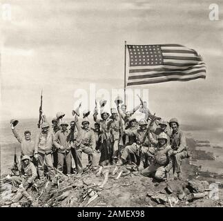 U.S. Marines on Iwo Jima captured Mount Suribachi, where they raised two American flags. 1945 - Stock Photo
