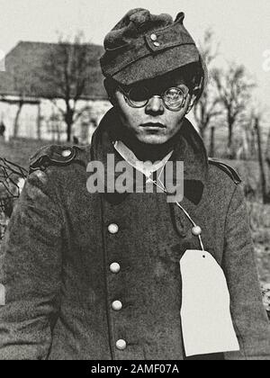 A 19-year-old German soldier captured by allies from the 7th US Army in the French border town of Forbach, Lorraine. France. March 1945 - Stock Photo