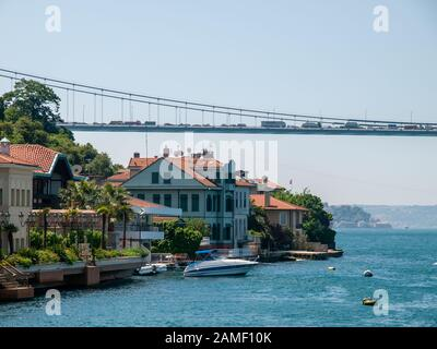 Istanbul, Turkey -  Bosporus strait residential buildings and second bosporus bridge as seen from ship cruising in canal sea. Summer vacations scene. - Stock Photo