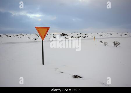 Solo upside down triangle standing in the snow in Iceland - Stock Photo
