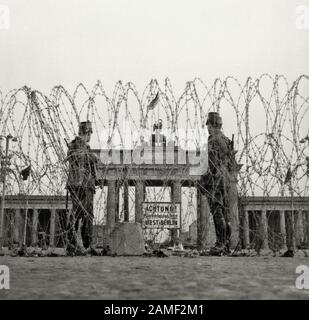 Building the Berlin wall: the first barbed wire fence at the Brandenburg gate. 1960s Stock Photo