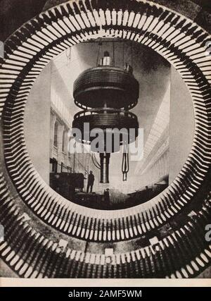 The life in Soviet Union in 1930s. From soviet propaganda book. Assembly of giant turbine - Stock Photo