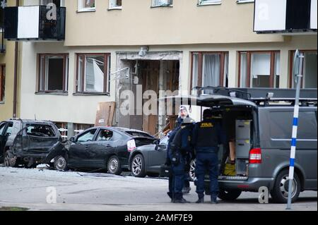 A very powerful explosion occurred at a multi-family house on Östermalm in Stockholm the night before Monday. The gate and cars were completely destroyed and several people were evacuated. - Stock Photo