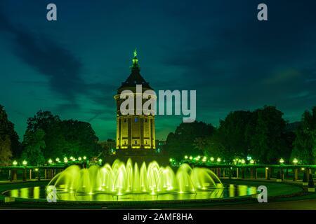 Mannheim - water tower in park w nightly illumination - Stock Photo