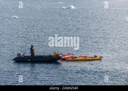 Inflatable boat with kayaks in Antarctica - Stock Photo