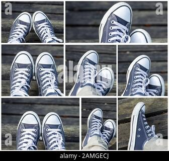 Set of blue sneakers on the feet on wooden background. Top view.