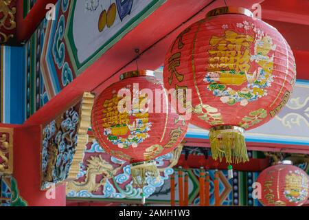 Chinese lanterns multicolored in chinese temple at day background - Stock Photo