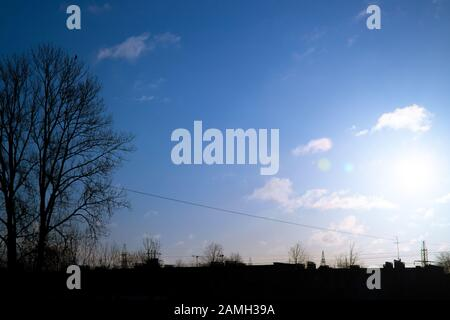Silhouette of the city under the sun - Stock Photo