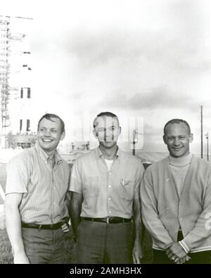 NASA's Apollo 11 flight crew, Neil A. Armstrong, commander, Michael Collins, command module pilot, and Edwin E. Aldrin Jr. lunar module pilot, standing near the Apollo/Saturn V space vehicle at the Kennedy Space Center, Merritt Island, Florida, United States, July 16, 1969. Image courtesy NASA. () - Stock Photo