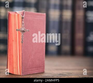 Christian cross necklace on a Holy Bible, Christianity and Religion concept. - Stock Photo