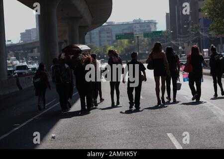 Mexico City, Mexico. 13th Jan, 2020. Transsexual activists protest in the central lanes of the peripheral in Mexico City, Mexico, 13 January 2020. Activists denounce impunity in transfeminicides such as Paola Buenrostro killed in 2016. Credit: EFE News Agency/Alamy Live News - Stock Photo