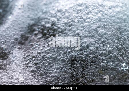 Boiling foam in a saucepan on an electric stove - Stock Photo