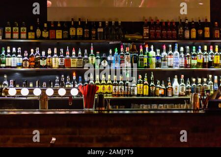 Lots of bottles on display at a cocktail bar, Prague, Czech Republic - Stock Photo