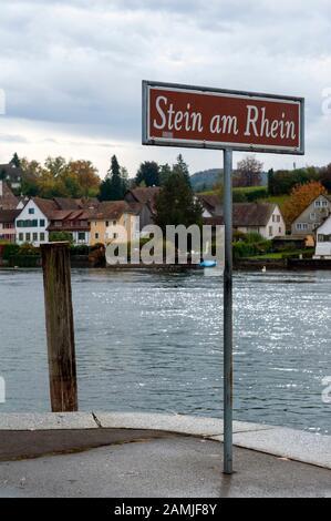 Signpost written Stein Am Rhein installed at the pier on the Rhine River at Stein Am Rhein, an old town in Schaffhausen, Switzerland - Stock Photo