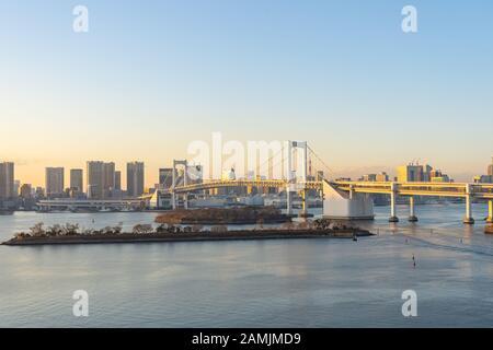 Tokyo skyline with view of Rainbow bridge in Japan. Stock Photo